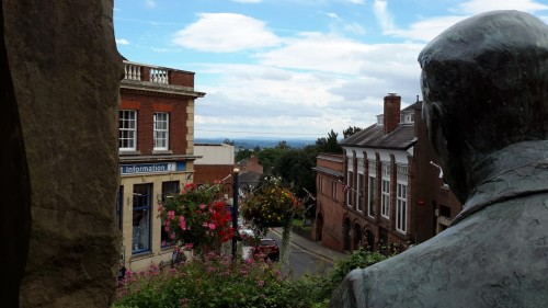 a statue edward elgar stands on Belle vue terrace, blue bird tearoom great malvern