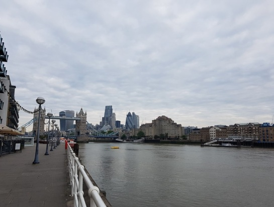 The view from Butler's Wharf looking back upstream of the Thames towards Tower Bridge and the City of London