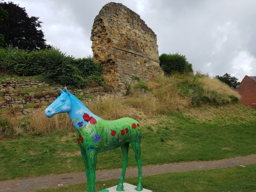 a beautiful horse sculpture in front of Tonbridge Castle