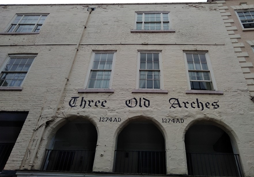 three old arches chester, chester, roman fort, chesters clock, roman city walls chester, explore chester, things to do in chester, chester high cross, britains oldest shopping arcade. black and white buildings of chester, domesday book town
